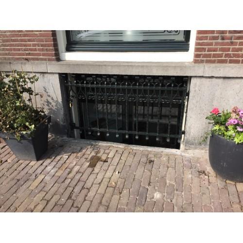 Raamroosters Kapitale pand in Amsterdam